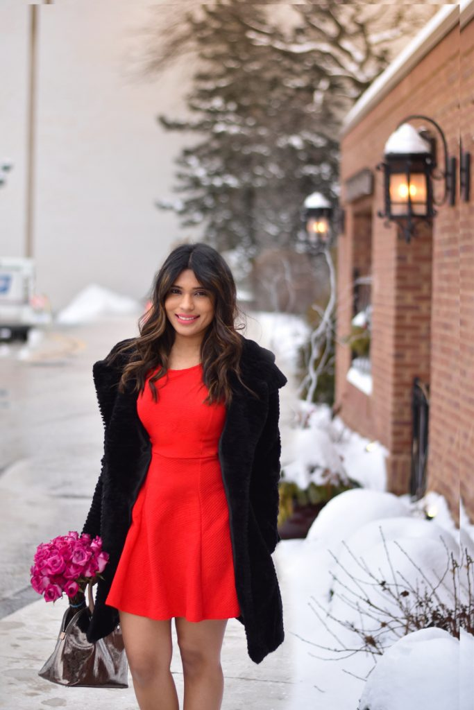 Red dress with black faux fur coat