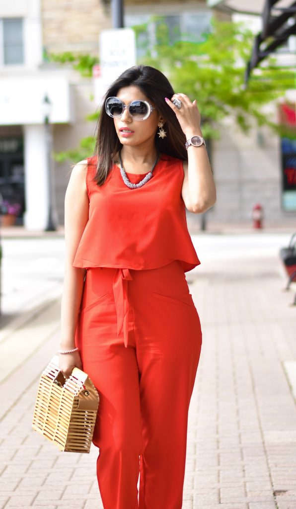 Red jumpsuit and sunnies